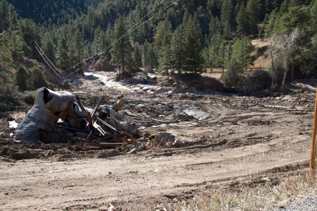 Debris, erosion and silting from a washed out. road